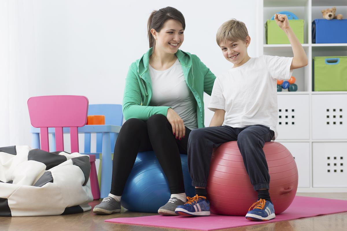 Student and teacher sitting on exercise balls