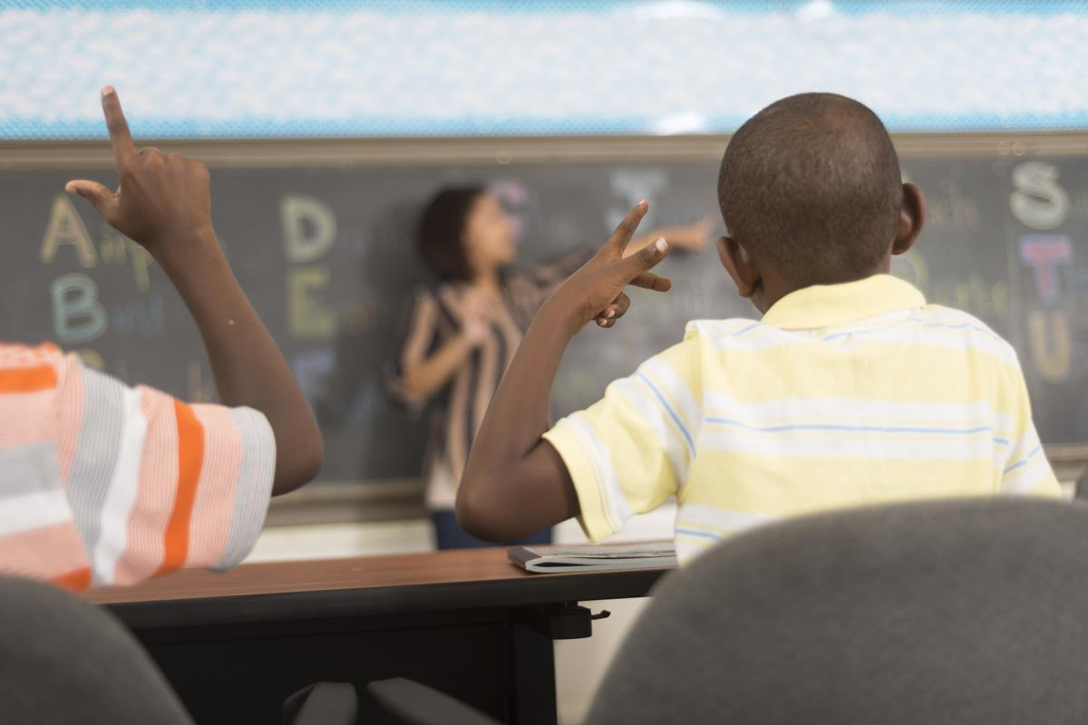 Students using sign language in the classroom