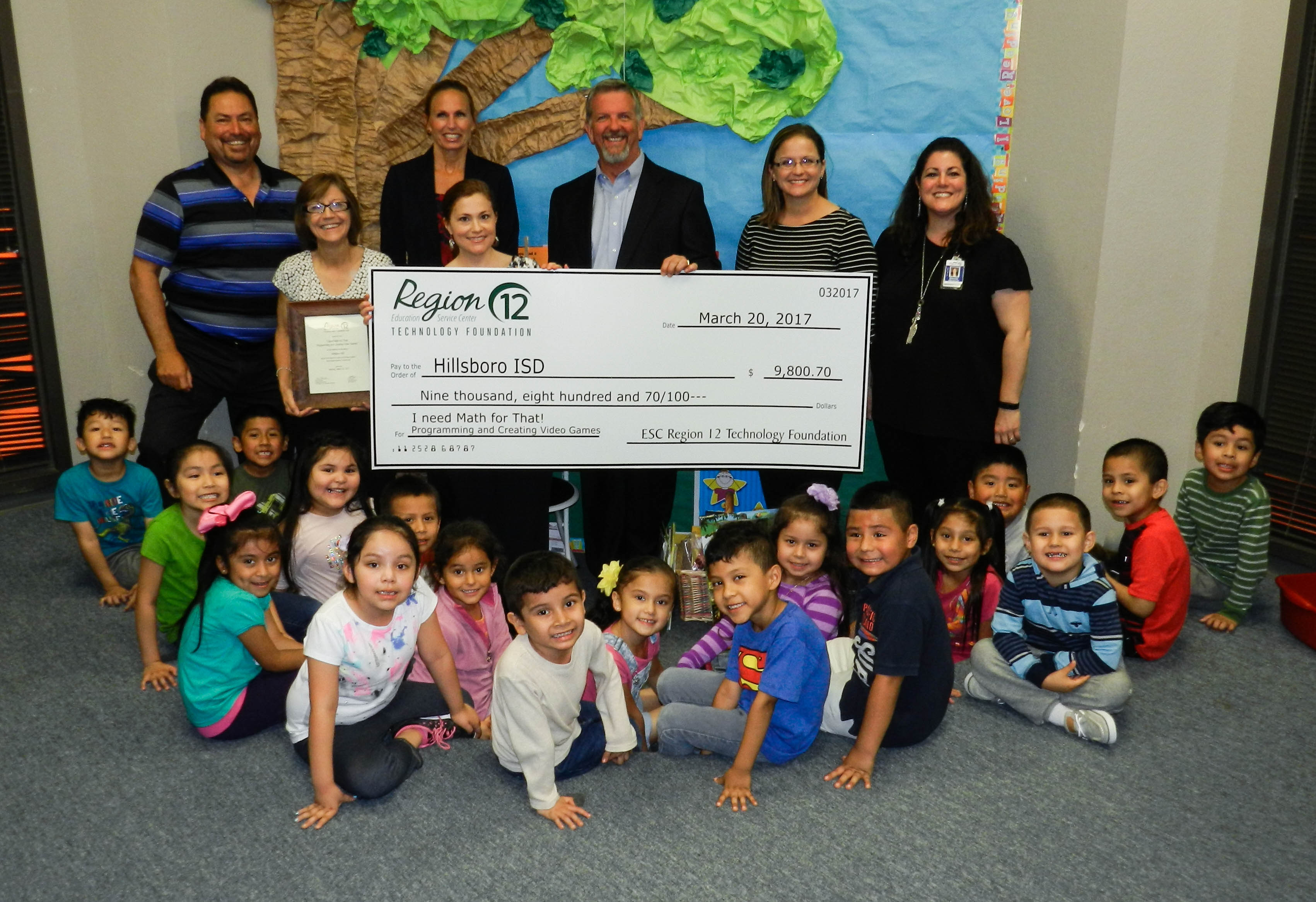 students of Hillsboro ISD pose with a large check they earned from the Technology Foundation