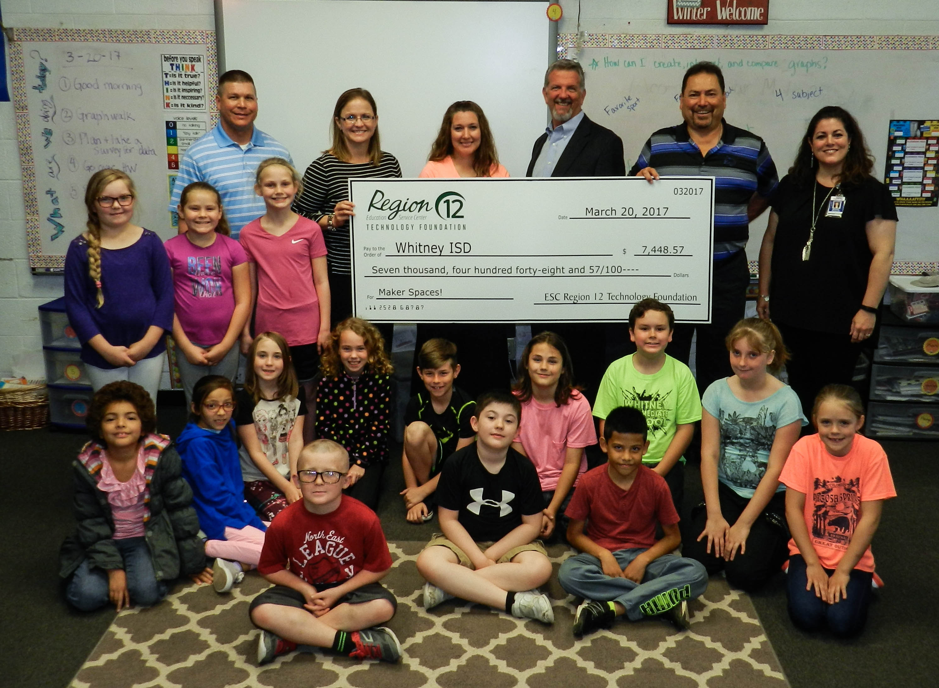 students of Whitney ISD pose with a large check they earned from the Technology Foundation